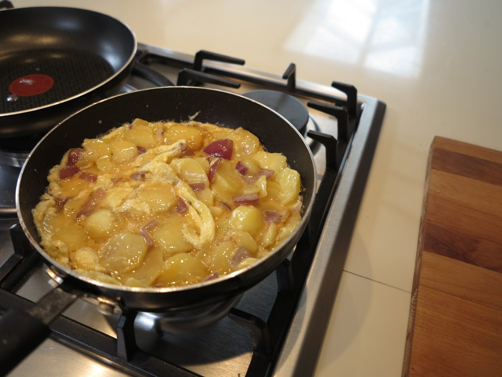 Saucepan with added onions and meat